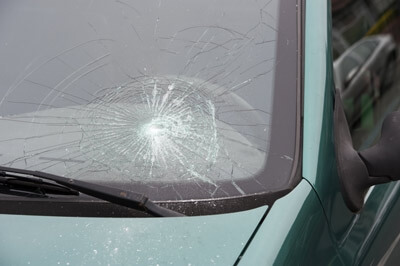 Broken Windshield to Replace with Used Auto Glass from Milwaukee Salvage Yard