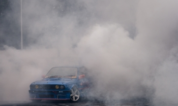 Blue BMW with White Smoke Coming from It