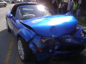 Blue Sports Car with Damage From Accident