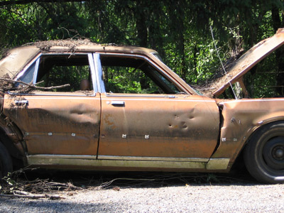 Unwanted Sedan Waiting to Be Sold to Salvage Yard