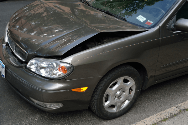 silver car with damaged front hood