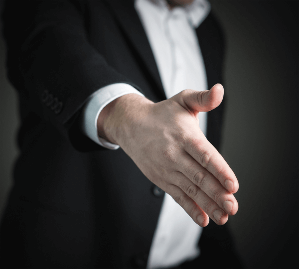 car salesman making a deal with a handshake