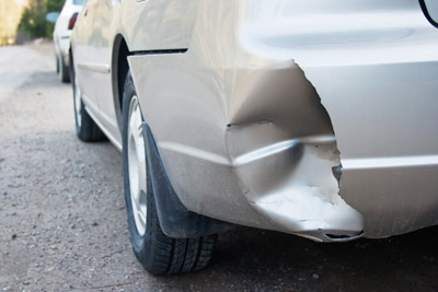 Damaged Car Bumper to Replace with Used Body Part from Junkyard