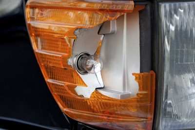 Smashed Car Headlight Needing Used Replacement from Salvage Yard